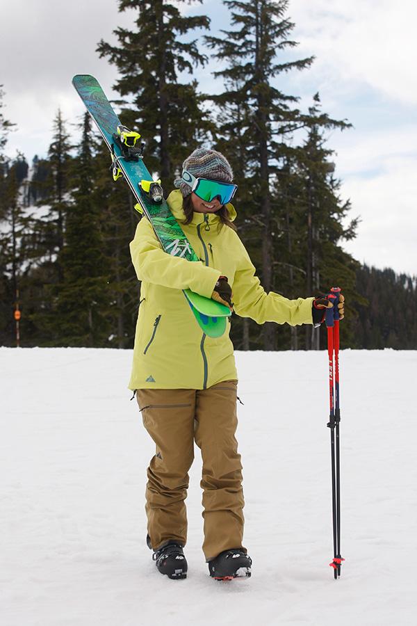 skier with gear over shoulder
