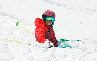 skier sitting in snow