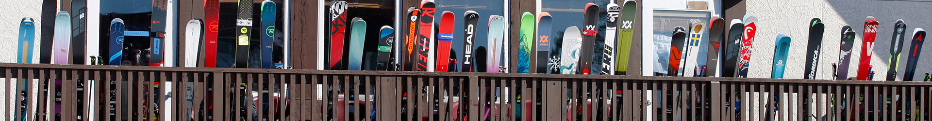 skis leaning on railing