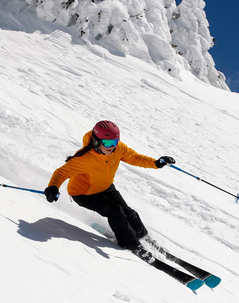 woman skiing on steep terrain
